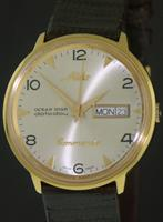 Pre-Owned MIDO COMMANDER AUTO DATODAY YELLOW